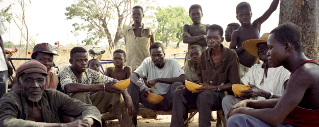 The village chief and the earth priest of Dadoune and several listeners during an interview, province Ioba, Burkina Faso, Nov. 1997 (photo: Carola Lentz)