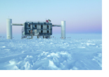 View over the ice at the geographic South Pole to the above ground measuring station of the IceCube observatory, where the data from the photo sensors in the ice is extracted and analyzed. (photo/©: Sven Lidstrom, IceCube/NSF)