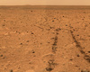 MER 'Spirit' looks back on the tracks which it left on the Martian surface at the beginning of its mission in 2004: signs of the presence of a man-made vehicle. In 2010, 'Spirit' sent its last radio message to the Earth. (image/©: NASA/JPL)